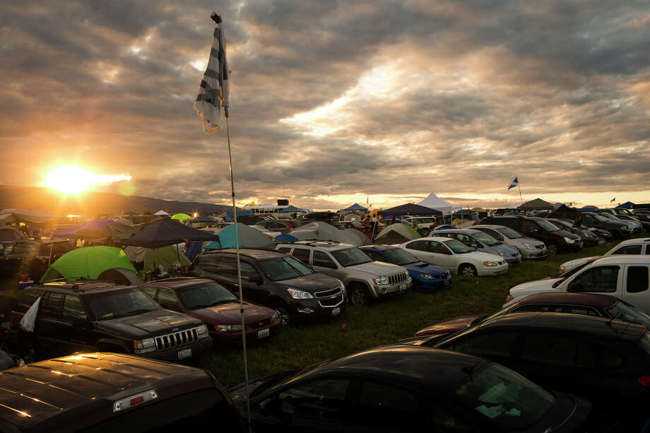 The sun sets over tens of thousands of cars and tents on the second day of the annual Sasquatch music festival Saturday, May 25, 2013, at The Gorge Amphitheatre in George. Photo: JORDAN STEAD, SEATTLEPI.COM / SEATTLEPI.COM