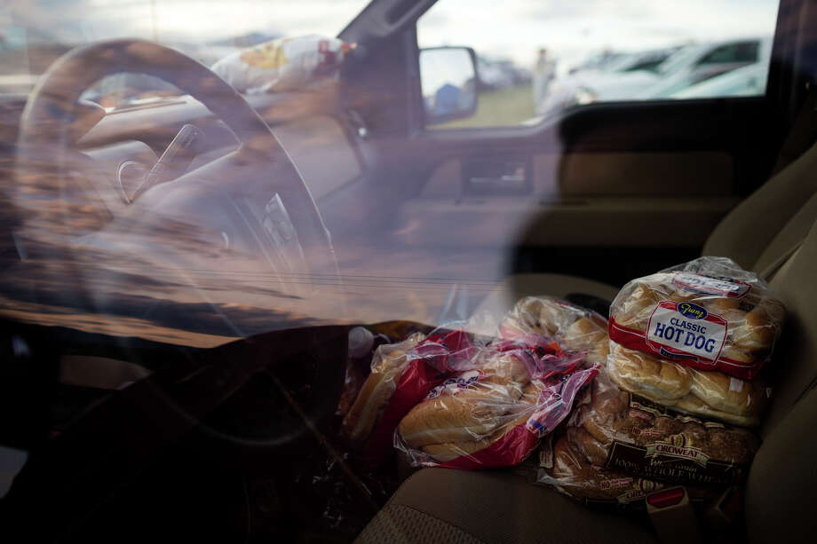 A staple food - hot dog buns - pile up in the front seat of a truck parked in the camping section of the annual Sasquatch music festival Saturday, May 25, 2013, at The Gorge Amphitheatre in George. Photo: JORDAN STEAD, SEATTLEPI.COM / SEATTLEPI.COM