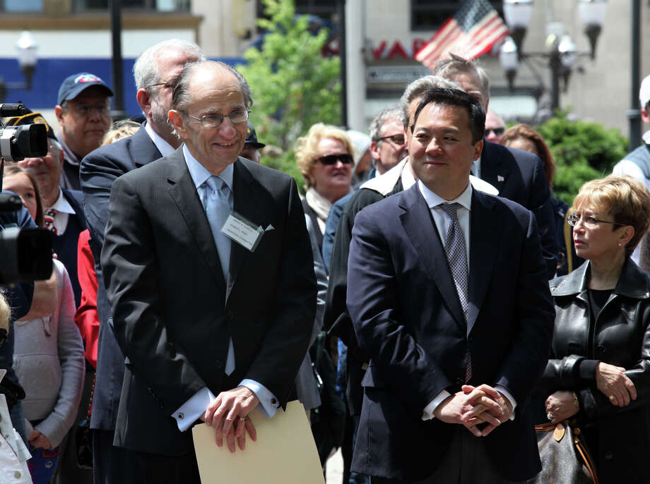James Vlasto, left, is acknowledged for his hard work during a dedication ceremony for Medal of Honor recipient Homer L. Wise after Stamford's Memorial Day parade on Sunday, May 26, 2013. Photo: BK Angeletti, B.K. Angeletti / Connecticut Post freelance B.K. Angeletti