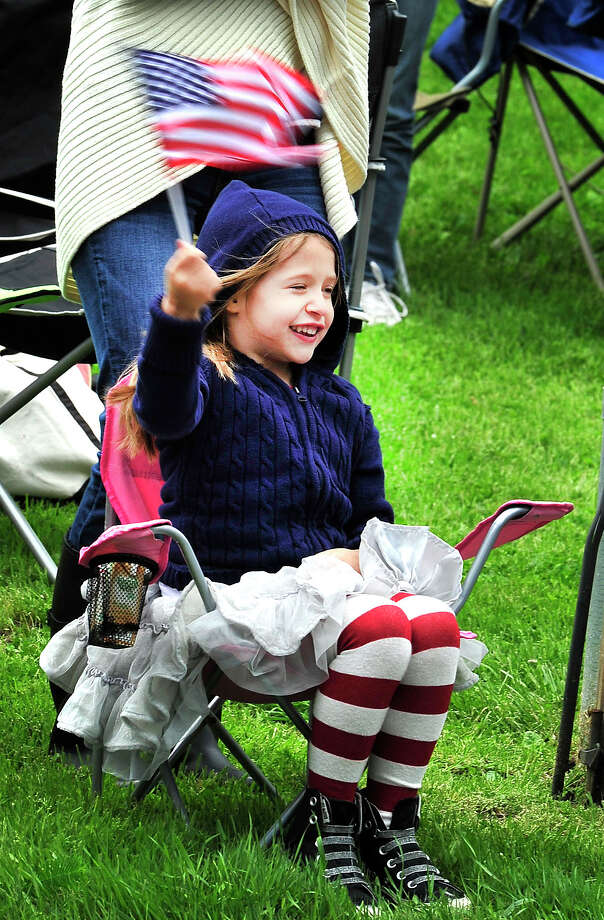 Kaylee Brower, 4, watches Brookfield's Memorial Day parade in Brookfield, Conn. Sunday, May 26, 2013. Photo: Michael Duffy / The News-Times