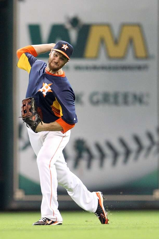 Astros outfielder Trevor Crowe makes a throw.