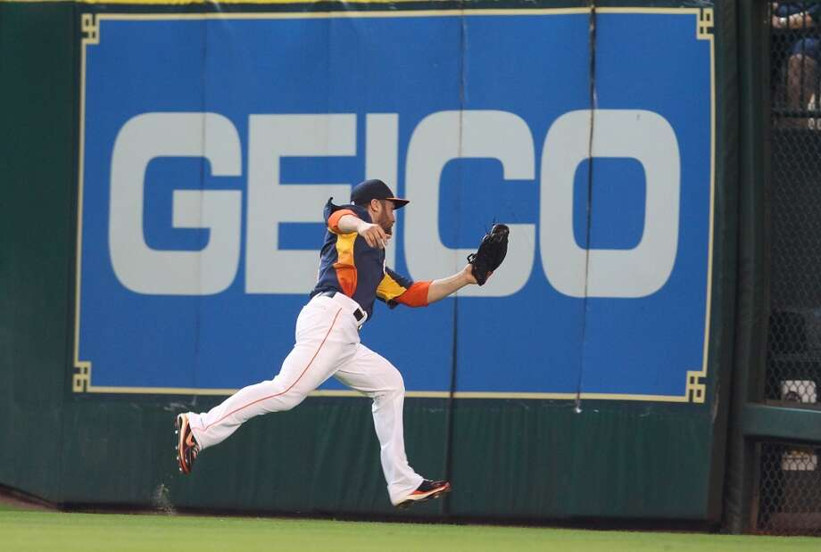 Trevor Crowe of the Astros makes a catch for an out in the outfield.