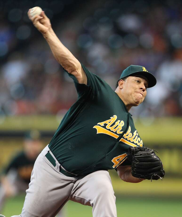 Bartolo Colon of the A's delivers a pitch to the Astros.