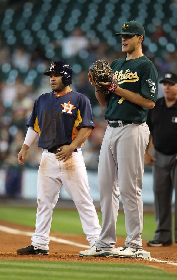 A's first baseman Nate Frieman towers over Jose Altuve of the Astros.