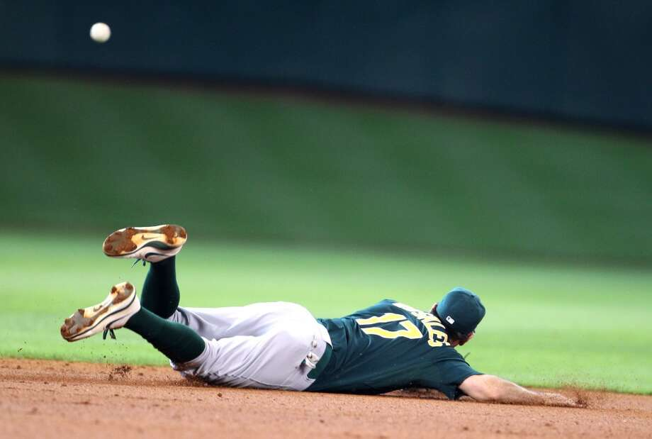 Adam Rosales of the A's is unable to make a play on the ball.
