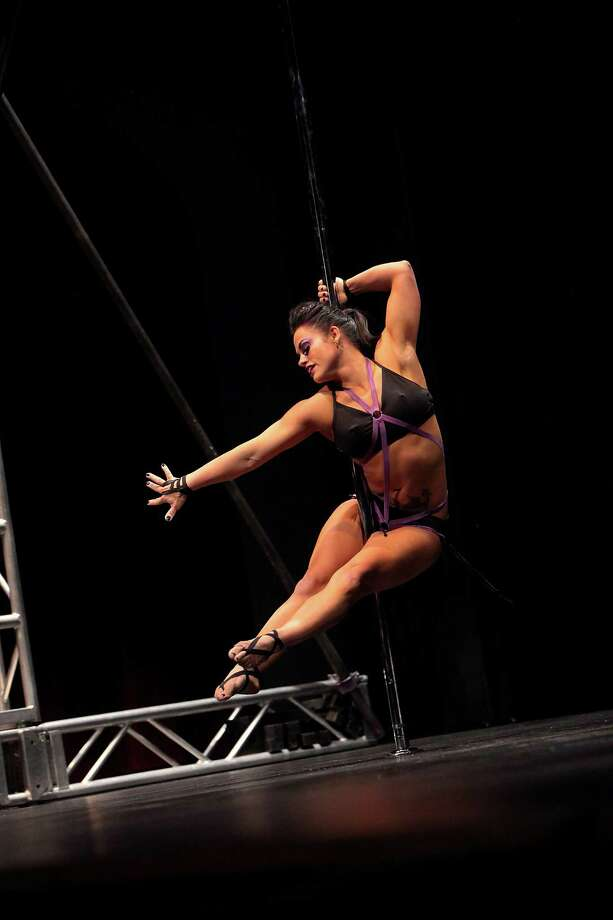 CHICAGO, IL - MAY 25: A pole dance artist performs at The 2013 Central Pole Dancing Competition on May 25, 2013 in Chicago, Illinois. Photo: Jeff Schear, Getty Images / 2013 Getty Images