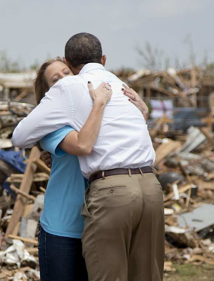 President Obama embraces Plaza Towers Elementary School Principal Amy Simpson during his tour of Moore, Okla. Photo: Carolyn Kaster, Associated Press