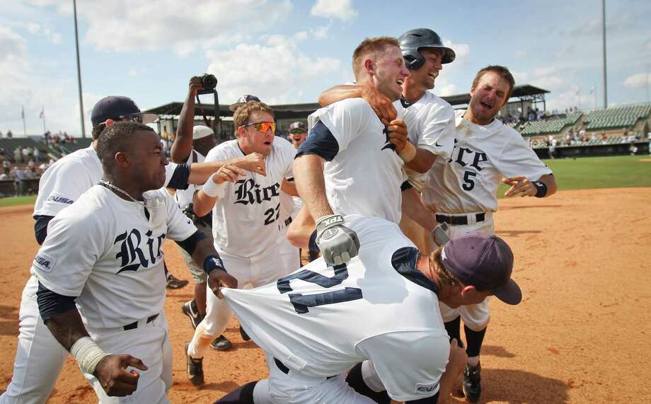 Rice's Keenan Cook, center, celebrates his game winning RBI with the rest of his teammates after beating Southern Mississippi for the Conference USA Baseball Championship Sunday in Reckling Park. Photo: Nick De La Torre, Chronicle / © 2013 Houston Chronicle