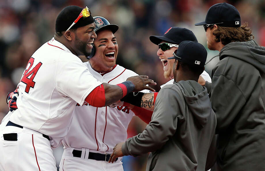 Boston Red Sox's Jacoby Ellsbury, second from left, is mobbed by David Ortiz, left, and other teammates after his walkoff two-run double during the ninth inning of a 6-5 win over the Cleveland Indians in a baseball game at Fenway Park in Boston, Sunday, May 26, 2013. (AP Photo/Winslow Townson) Photo: Winslow Townson