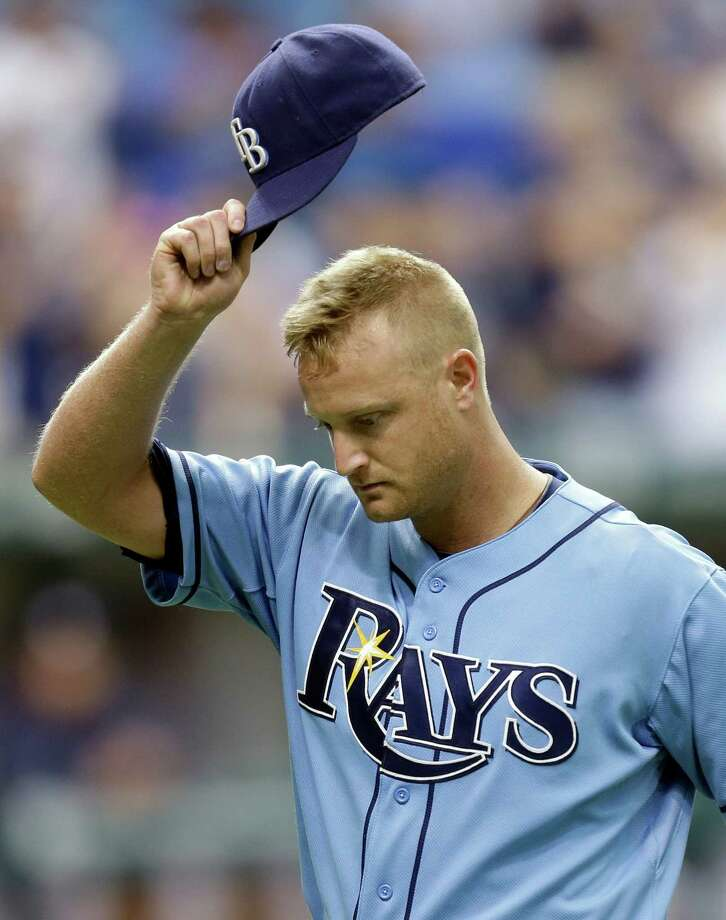 Tampa Bay Rays starting pitcher Alex Cobb tips his cap to the crowd after being taken out of the game in the ninth inning against the New York Yankees during a baseball game Sunday, May 26, 2013, in St. Petersburg, Fla. (AP Photo/Chris O'Meara) Photo: Chris O'Meara