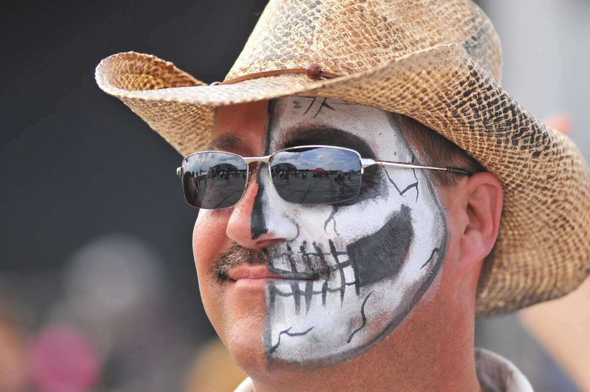 Noel Herbert of Lafayette, La., has his face painted like a skeleton and enjoys the first annual River City Rockfest at the AT&T Center Sunday afternoon, May 26, 2013,.