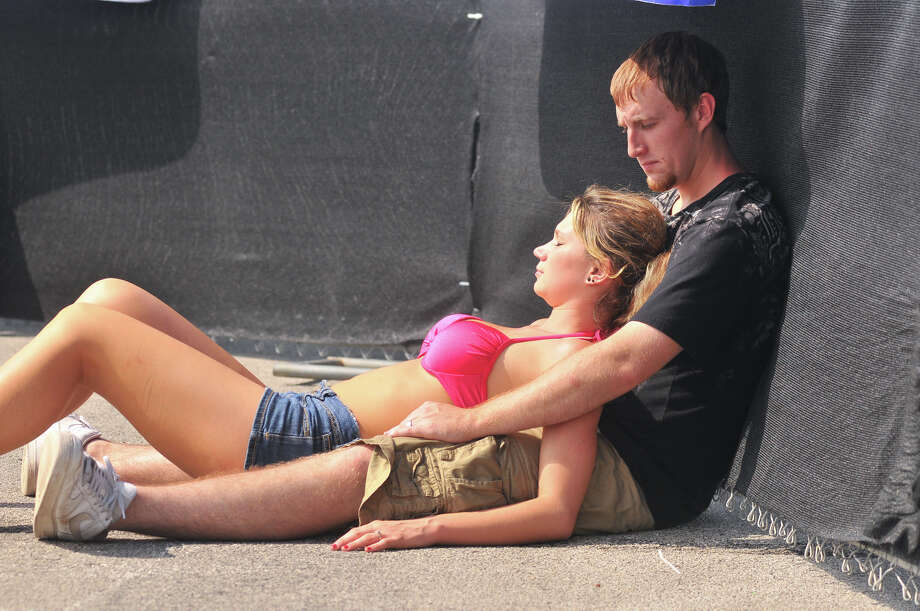 Despite the rain that drenched San Antonio over the weekend, Brody and Ashley Webb take a brief respite in the sun during the first annual River City Rockfest at the AT&T Center Sunday afternoon, May 26, 2013. Photo: Robin Jerstad, For The San Antonio Express-News