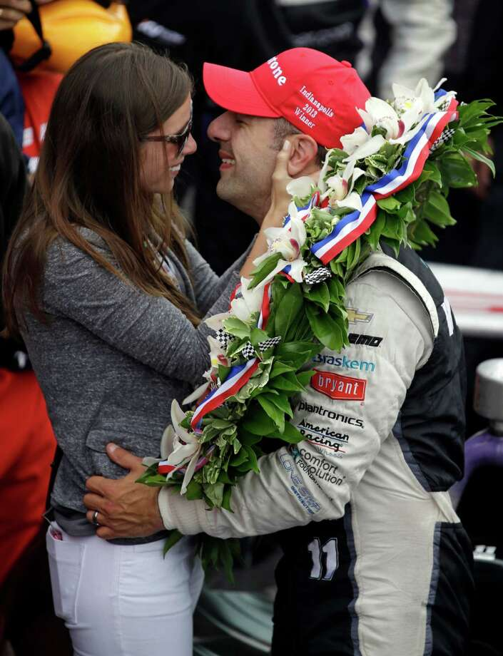 Tony Kanaan, of Brazil, kisses his wife Lauren Bohlander Kanaan after winning the Indianapolis 500 auto race at the Indianapolis Motor Speedway in Indianapolis, Sunday, May 26, 2013. (AP Photo/Michael Conroy) Photo: Michael Conroy, Associated Press / AP