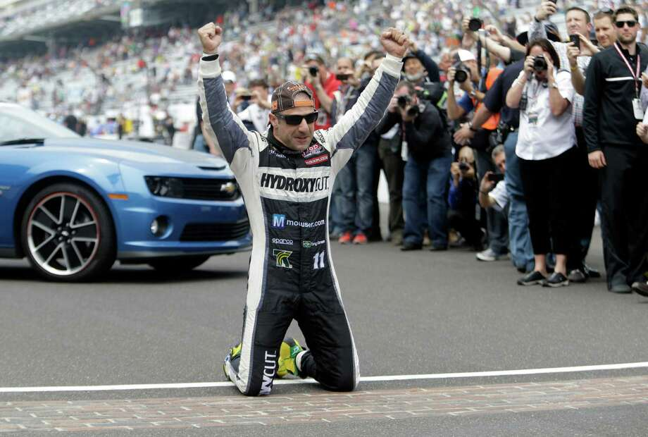 Tony Kanaan, of Brazil, celebrates on the start/finish line after winning the Indianapolis 500 auto race at the Indianapolis Motor Speedway in Indianapolis, Sunday, May 26, 2013. (AP Photo/Tom Strattman) Photo: Tom Strattman, Associated Press / FR29600 AP
