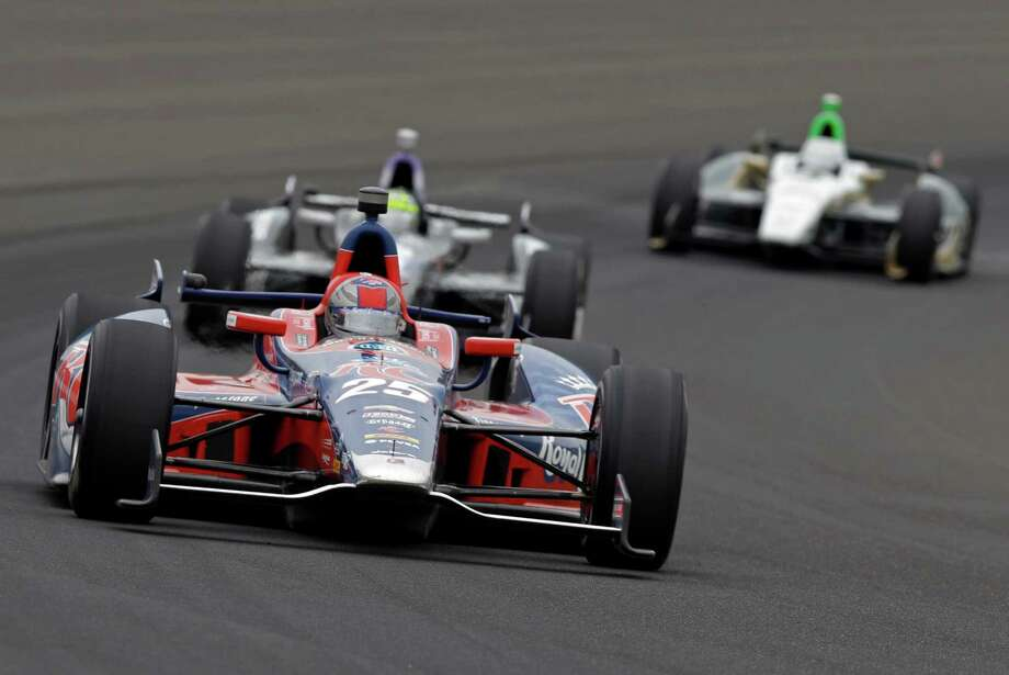 Marco Andretti drives through the first turn during the Indianapolis 500 auto race at Indianapolis Motor Speedway in Indianapolis, Sunday, May 26, 2013. (AP Photo/Tom Strattman) Photo: Tom Strattman, Associated Press / FR29600 AP