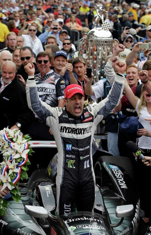Tony Kanaan, of Brazil, celebrates after winning the Indianapolis 500 auto race at the Indianapolis Motor Speedway in Indianapolis, Sunday, May 26, 2013. (AP Photo/Darron Cummings) Photo: Darron Cummings, Associated Press / AP