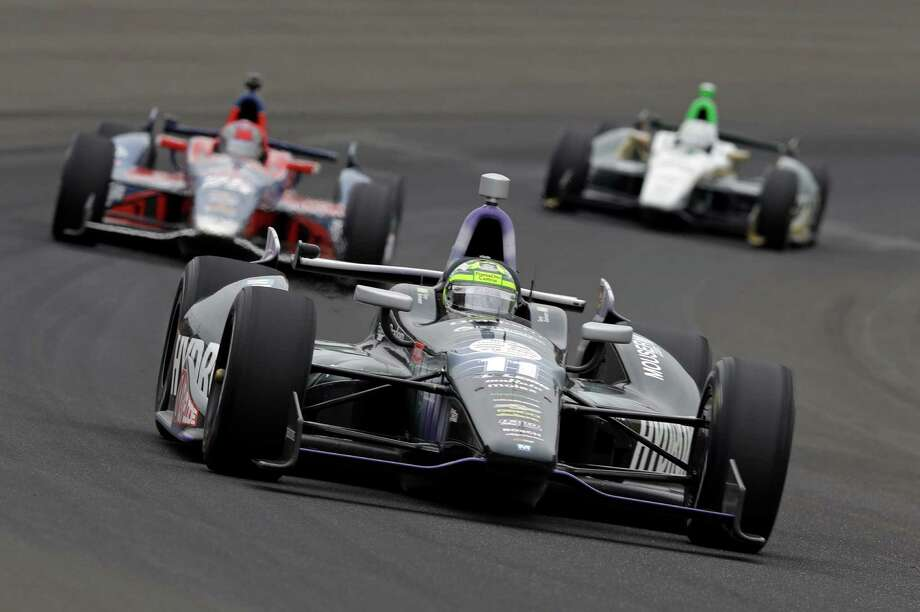 Tony Kanaan, of Brazil, drives through the first turn during the Indianapolis 500 auto race at the Indianapolis Motor Speedway in Indianapolis Sunday, May 26, 2013. (AP Photo/Tom Strattman) Photo: Tom Strattman, Associated Press / FR29600 AP