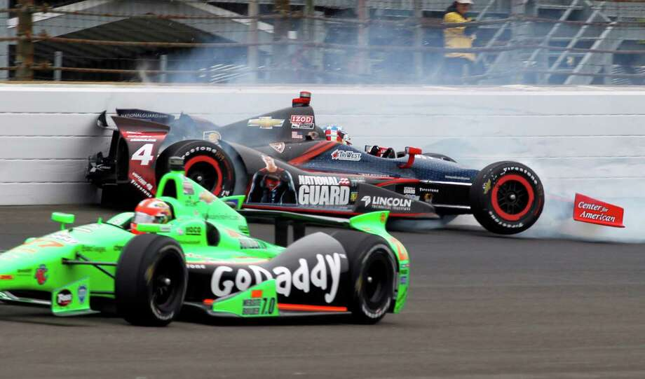 CORRECTS THAT ACCIDENT IS DURING THE RACE - James Hinchcliffe, of Canada, bottom, goes under as JR Hildebrand hits the wall in the first turn during the Indianapolis 500 auto race at the Indianapolis Motor Speedway in Indianapolis Sunday May 26, 2013. (AP Photo/Bill Friel) Photo: Bill Friel, Associated Press / AP