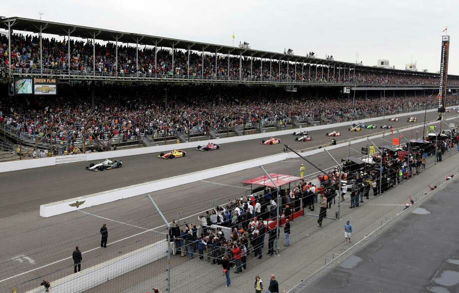 Ed Carpenter leads the field into the first turn on the start of the Indianapolis 500 auto race at the Indianapolis Motor Speedway in Indianapolis, Sunday, May 26, 2013. (AP Photo/Darron Cummings) Photo: Darron Cummings, Associated Press / AP