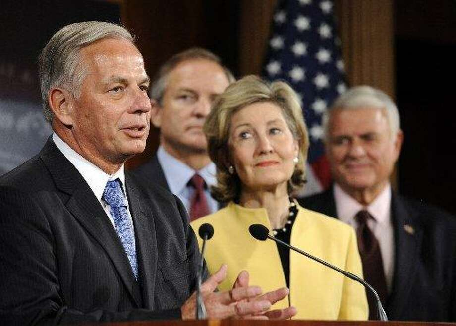 Houston Rep. Gene Green and Texas Sen. Kay Bailey Hutchison at a bipartisan press conference. In the rear are former Rep. Chet Edwards of Waco and Rep. John Carter of Round Rock.