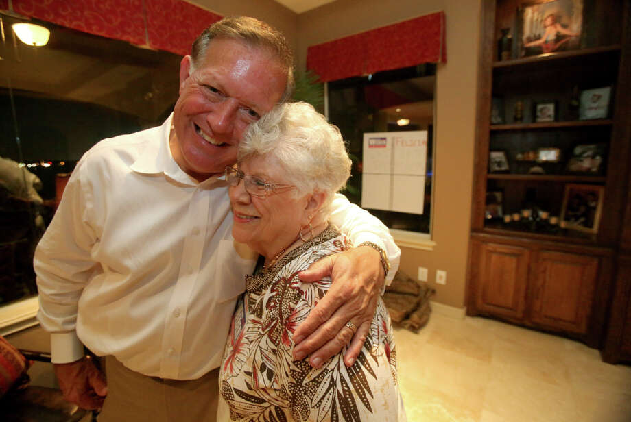 7/31/12: Randy Weber gets a hug from his mother Jeanne Webber after announcing that he had won the race for  the Texas house race in district 14 on Election Night gathering at the home of Brian and Mary Orsak, in League City, Texas.  For the Chronicle: Thomas B. Shea Photo: Thomas B. Shea, For The Chron /  © 2012 Thomas B. Shea