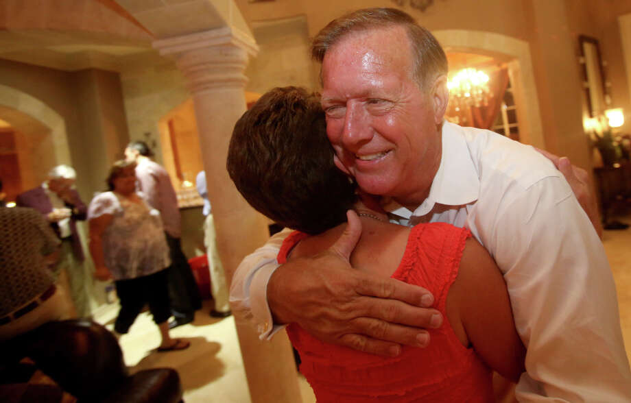 7/31/12: Randy Weber for the Texas house race in district 14 hugs his wife Brenda after he found out that he won district 14 on Election Night at the home of Brian and Mary Orsak, in League City, Texas.  For the Chronicle: Thomas B. Shea Photo: Thomas B. Shea, For The Chron /  © 2012 Thomas B. Shea