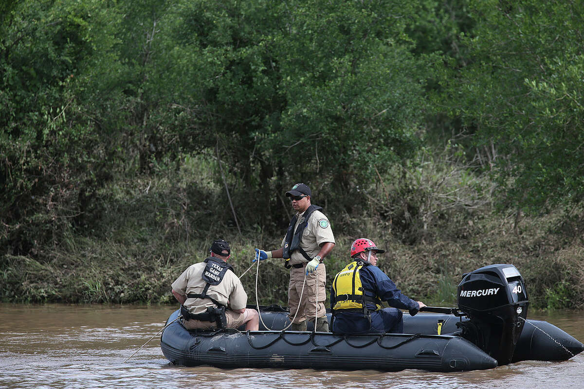 Emergency personnel search the Cibolo Creek for the body of 18-year-old Avron Adams, Sunday, May 26, 2013, Adam drowned when swimming the rain swollen creek on Saturday in Schertz. The body was recovered later in the afternoon.