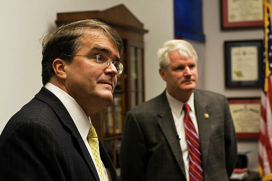 "Rep. John Culberson (R-TX) and Brian Baird (D-WA) listen to a journalist's question about open access to closed-door meetings. The two lawmakers received ""Sunlight on the Hill"" awards from the Sunlight Foundation for introducing H.Res.554, a rule change requiring legislation be posted online 72 hours before a vote. (Sunlight Foundation)"