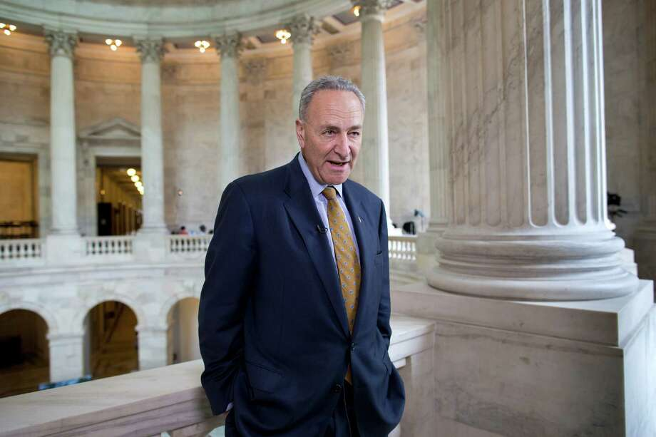 "FILE – In this May 6, 2013, file photo Sen. Chuck Schumer, D-N.Y., talks during a television news interview on Capitol Hill in Washington. Schumer is proposing legislation that would set additional rules for how leaks about government secrets are investigated. He said Sunday, May 26, 2013, on CBS' ""Face the Nation"" that when the government is going to ask a news organization to divulge information it first must go to a judge. He says that judge would ""impose a balancing test"" to determine which is more important, the government's desire to find the information or the robust freedom of the press.  (AP Photo/J. Scott Applewhite, File) Photo: J. Scott Applewhite"