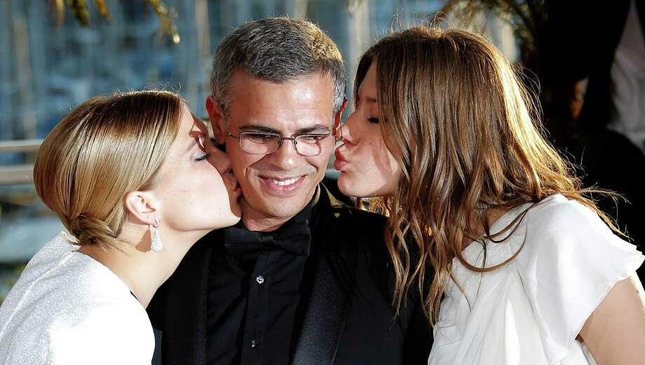 Actress Lea Seydoux, from left, director Abdellatif Kechiche and Adele Exarchopoulos celebrate winning the Cannes Film Festival's highest award. Photo: Lionel Cironneau, STR / AP