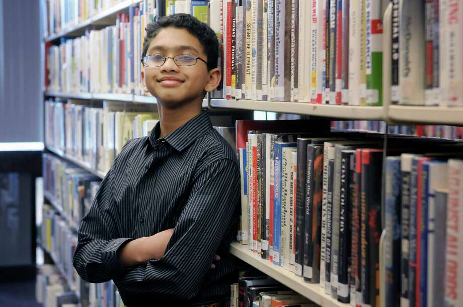 Ryan Devanandan, a Sand Creek Middle School student, poses for a photograph at the William K. Sanford Library on Monday, May 13, 2013 in Colonie, NY.  Devanandan won the regional spelling bee and heads to the national bee in Washington, D.C., later this month.  (Paul Buckowski / Times Union) Photo: Paul Buckowski