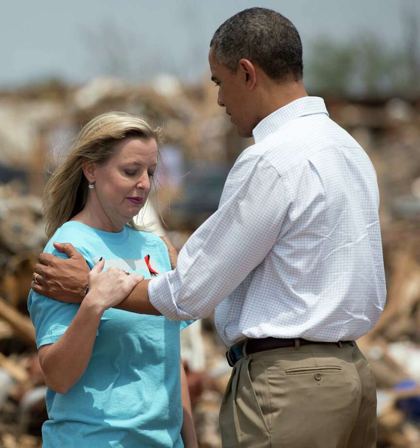 President Barack Obama tries to comfort Plaza Towers Elementary School principal Amy Simpson Sunday May 26, 2013, in Moore, Okla., as he views the devastation of the school caused by tornado and severe weather last week.  (AP Photo/Carolyn Kaster) Photo: Carolyn Kaster