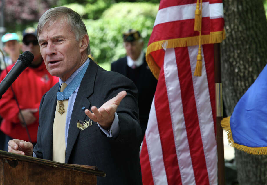 Medal of Honor recipient Paul Bucha speaks during a dedication ceremony for Medal of Honor recipient Homer L. Wise after Stamford's Memorial Day parade on Sunday, May 26, 2013. Photo: BK Angeletti, B.K. Angeletti / Connecticut Post freelance B.K. Angeletti