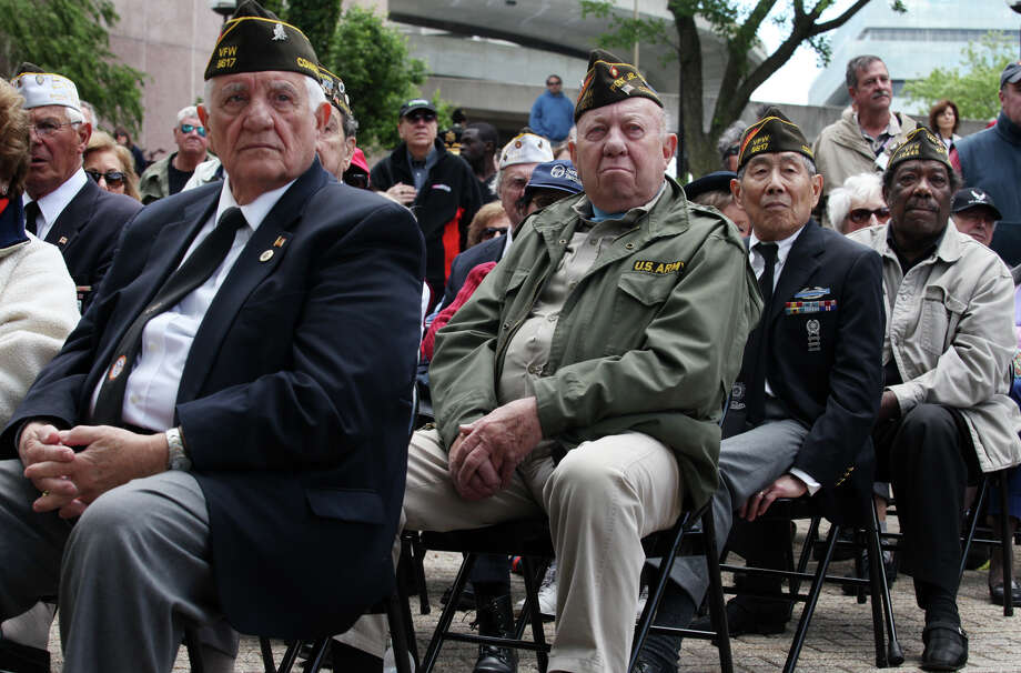 Veterans, dignitaries, and community members hold a dedication ceremony for Medal of Honor recipient Homer L. Wise after Stamford's Memorial Day parade on Sunday, May 26, 2013. Photo: BK Angeletti, B.K. Angeletti / Connecticut Post freelance B.K. Angeletti