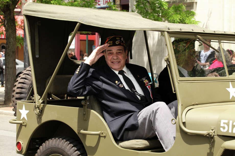 Korean War veteran Gino Romano salutes during   the Stamford Memorial Day parade on Sunday, May 26, 2013. Photo: BK Angeletti, B.K. Angeletti / Connecticut Post freelance B.K. Angeletti
