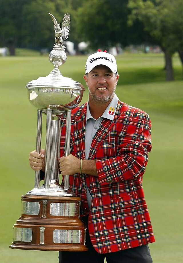 Boo Weekley, winner of the Crowne Plaza Invitational at Colonial, holds the Marvin Leonard Trophy, Sunday, May 26, 2013, in Fort Worth, Texas. (Richard W. Rodriguez/Fort Worth Star-Telegram/MCT) Photo: Richard W. Rodriguez, McClatchy-Tribune News Service