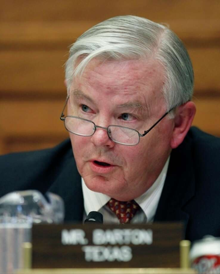 "FILE - In this June 17, 2010 file photo, Rep. Joe Barton, R-Texas,questions BP CEO Tony Hayward during the House Oversight and Investigations subcommittee hearing on the role of BP in the Deepwater Horizon Explosion and oil spill on Capitol Hill in Washington. During the hearing Barton accused the White House of doing a $20 billion ""shakedown"" by pushing BP to create compensation fund for Gulf oil victims. Erin Ryan, a tea party activist in Redding, Calif., said Barton was correct to use the word ""shakedown.""  (AP Photo/Alex Brandon, File) Photo: AP"
