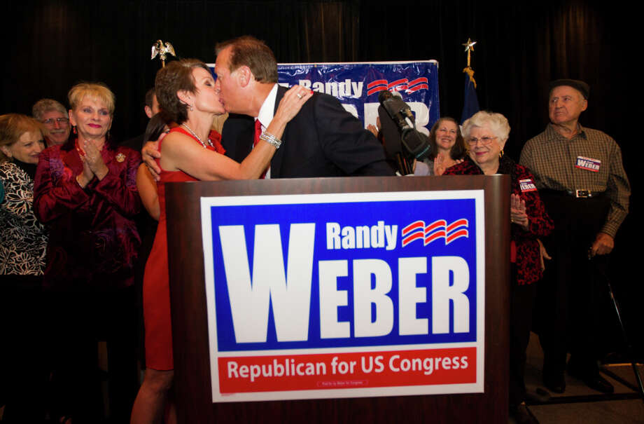 Newly elected Republican candidate for Congressional District 14 Randy Weber gives his wife Brenda a kiss after a victory speech at the South Shore Harbor Resort and Conference Center on Tuesday, Nov. 6, 2012, in League City. Weber defeated Democratic candidate Nick Lampson. Photo: J. Patric Schneider, For The Chronicle / © 2012 Houston Chronicle