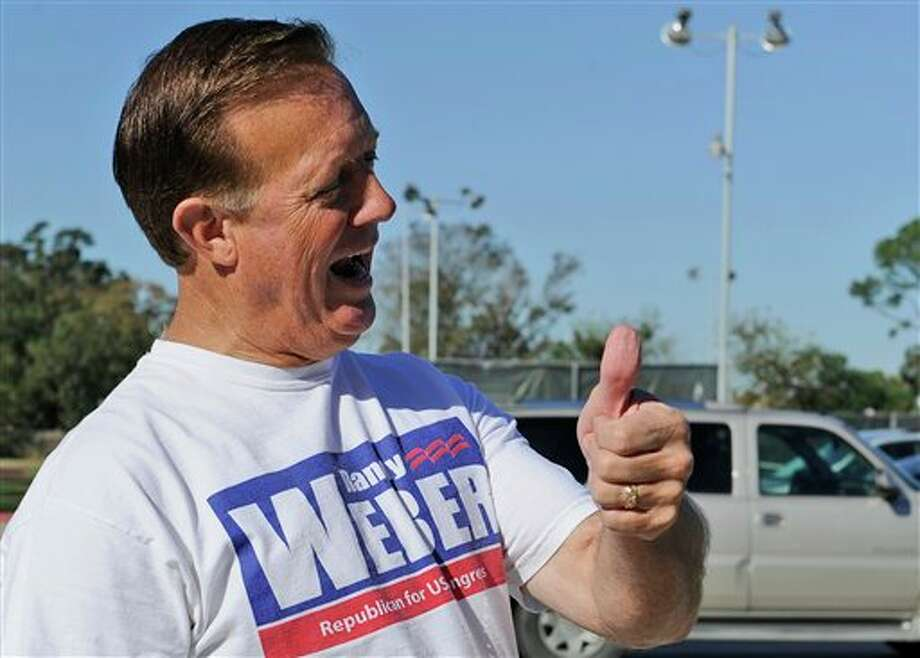 Republican congressional candidate Randy Weber gives a thumbs-up to a voter at a polling site Tuesday, Nov. 6, 2012, in Beaumont, Texas. Weber faces former Democratic congressman Nick Lampson for Ron Paul's seat in Congress. (AP Photo/Pat Sullivan) Photo: Pat Sullivan, AP / AP
