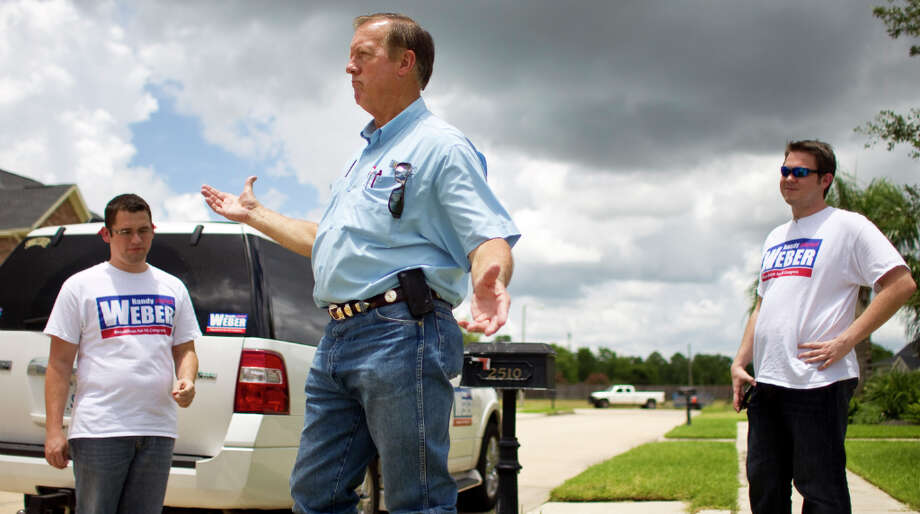 Randy Weber, a Republican candidate U.S. Congress,explains that he visits homes that polls show support his views as he campaigns door-to-door, Thursday, July 19, 2012, in League City. ( Nick de la Torre / Houston Chronicle ) Photo: Nick De La Torre, Houston Chronicle / © 2012  Houston Chronicle