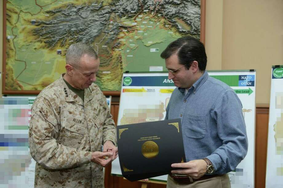 Sen. Ted Cruz receives a challenge coin from ISAF Commander Gen. John Allen (USMC).
