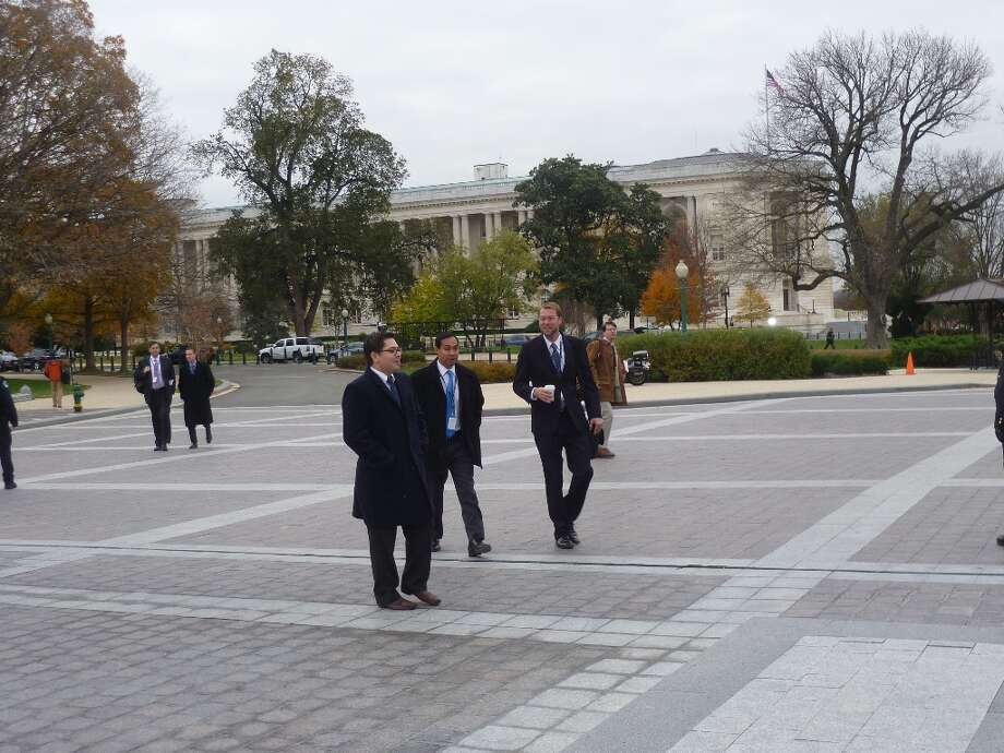 Joaquin Castro approaches the Capitol early morning on Nov. 15.
