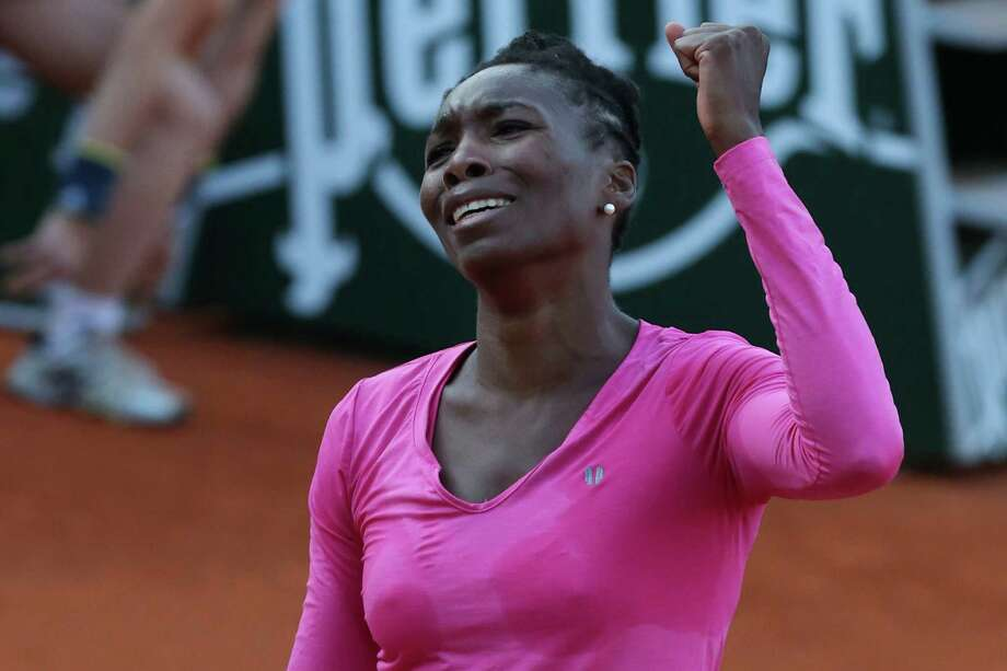 Venus Williams of the U.S. clenches her fist after winning the second set against Poland's Urszula Radwanska in their first round match of the French Open tennis tournament, at Roland Garros stadium in Paris, Sunday, May 26, 2013. (AP Photo/Michel Euler) Photo: Michel Euler