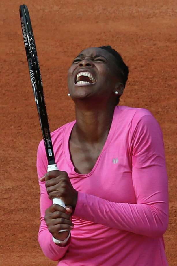 Venus Williams of the U.S. screams after missing a return a return against Poland's Urszula Radwanska in their first round match of the French Open tennis tournament, at Roland Garros stadium in Paris, Sunday, May 26, 2013. (AP Photo/Michel Euler) Photo: Michel Euler
