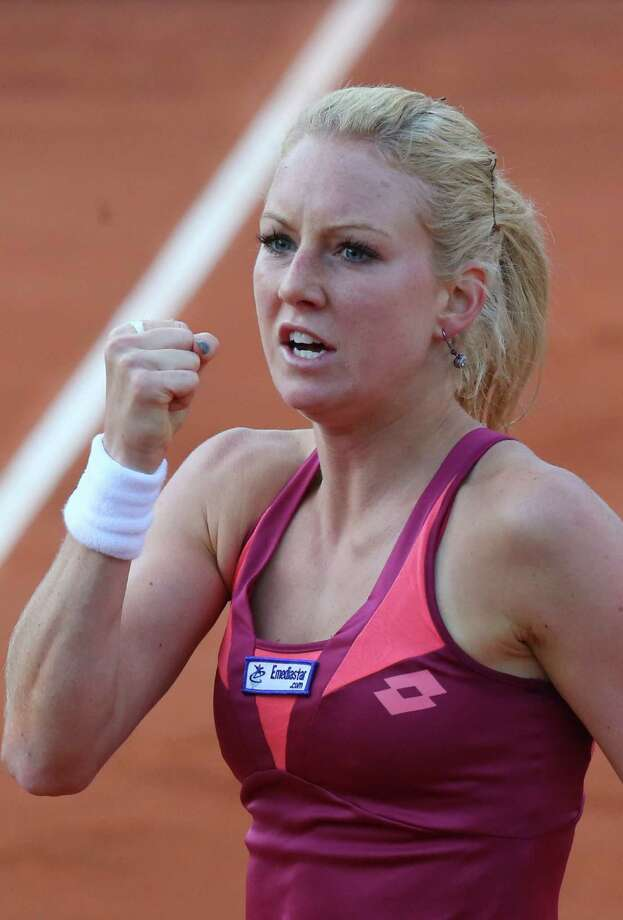 Poland's Urszula Radwanska clenches her fist when scoring a point against Venus Williams of the U.S. in their first round match of the French Open tennis tournament, at Roland Garros stadium in Paris, Sunday, May 26, 2013. (AP Photo/Michel Euler) Photo: Michel Euler