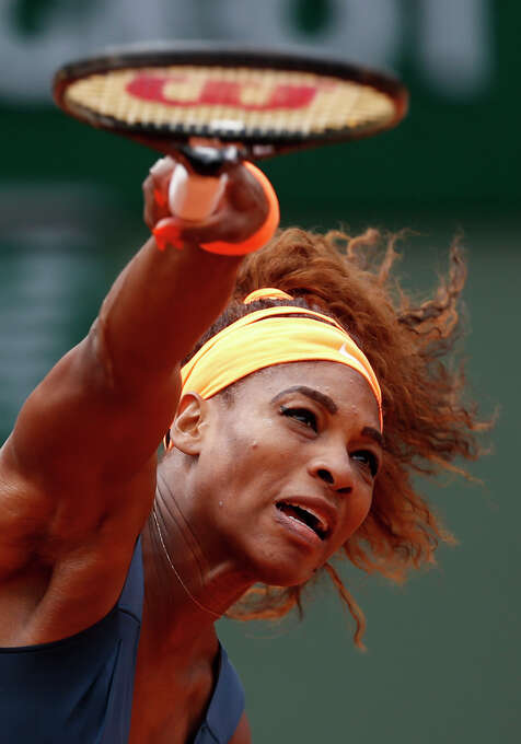 Serena Williams, of the USA, serves the ball to Georgia's Anna Tatishvili during their first round match of the French Open tennis tournament at the Roland Garros stadium Sunday, May 26, 2013 in Paris. (AP Photo/Petr David Josek) Photo: Petr David Josek