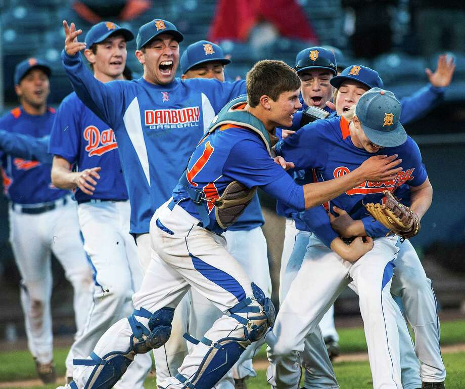 The Danbury high school baseball team comes out to congratulate pitcher, Corey Brosz, after defeating Trumbull high school in the FCIAC baseball championship game played at The Ballpark at Harbor Yard, Bridgeport, CT on Sunday May 26th, 2013. Photo: Mark Conrad / Connecticut Post Freelance
