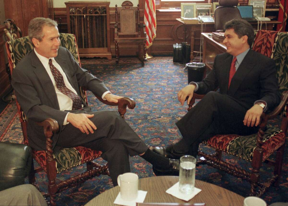 Former governor of the Mexican state Tamaulipas Tomas Yarrington, right, often visited Texas, appearing at events with Texas governors George W. Bush, left, and Rick Perry. His attorney claims Yarrington owns none of the Texas properties seized and believes the forfeitures are about flushing out cartel-related witnesses.