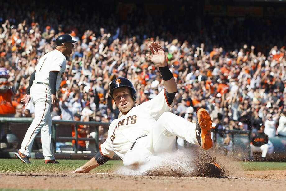 Buster Posey slides home on Hunter Pence's two-run double in the sixth inning, making it 7-2. Photo: Jason O. Watson, Getty Images