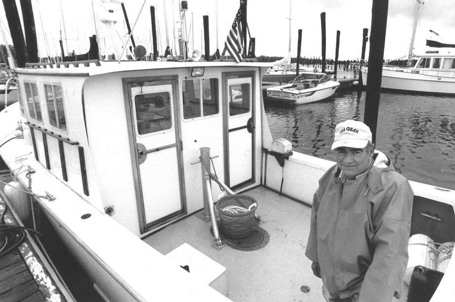 Nelson Porter is shown here aboard his commercial towing boat Trish at Yacht Haven West marina in May 1988, five years after the Coast Guard was prohibited from offering free tows to boaters. Photo: Advocate